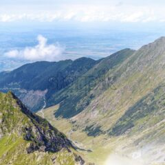 Fagaras Mountains from top view. Blue sky with clouds on backgorund. Paltinu saddle, Romania