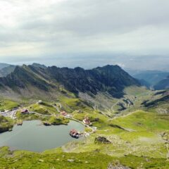 Scenery of Balea Lake and serpentine road in Fagaras Mountains, Romania. Cloudy sky. Wide shot