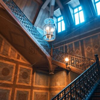Medieval wooden staircase in a palace. Orange and teal colors, paris, france - starpik