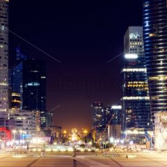 Paris city at night with business buildings and glass towers, France