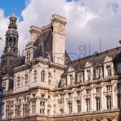 Wide panorama of Hotel de Ville in Paris. Shot during the day with some soft clouds covering the sun making a dramatic effect with a slight magenta look
