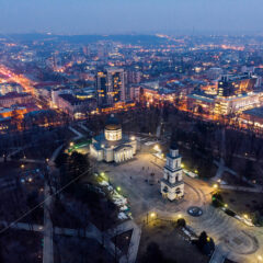 Aerial drone view of chisinau city center at night with lights and blue sky, nativity cathedral, Moldova