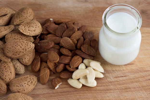Almond nuts with white milk macro close up composition - Starpik Stock