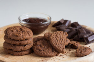 Brown biscuits with dark chocolate composition on a table - Starpik Stock