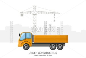 Building under construction with yellow truck in front. Place for text - Starpik Stock
