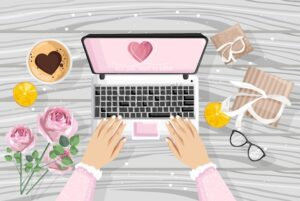 Girl using laptop with romantic gifts site. Glasses, boxes, coffee, rose flowers on wooden background. View from top. Love day vector - Starpik Stock