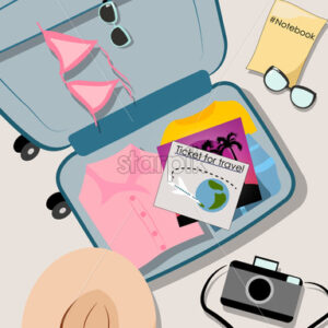 Overhead shot of opened suitcase filled with vacation clothes. Shirts, bathing suit, notebook, camera, hat and airplane travel ticket. Vector - Starpik Stock