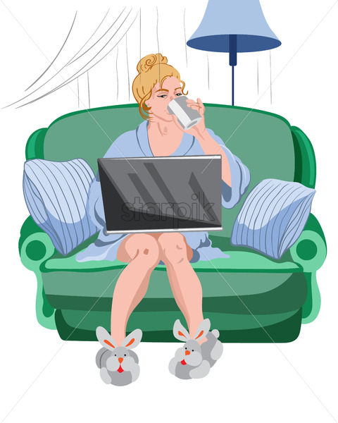 Woman working from home on a laptop. Cozy environment with rabbit slippers and sofa with pillows - Starpik Stock