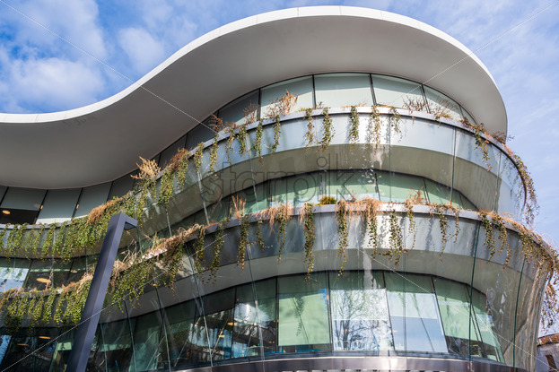 Amazing facade of the commerciale building in the city of Bucharest, Romania - Starpik Stock