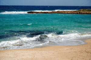 Beach and blue, clear water of Mediterranean sea in Ayia Napa - Starpik Stock