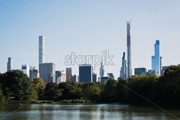Color DSLR landscape picture of Turtle Pond in Central Park, beautiful panorama of the New York City, USA - Starpik Stock