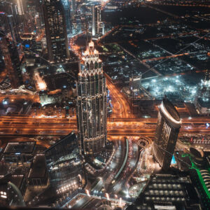 Colourful view of Dubai, United Arab Emirates. Aerial view on highways and skyscrapers. Wide angle shot of the cityscape - Starpik Stock
