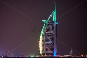 DUBAI, UNITED ARAB EMIRATES – FEBRUARY 23, 2019: Burj Al Arab with colorful lights at night - Starpik Stock