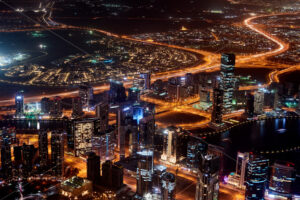 Dubai Cityscape at sunset blue hour from tallest building view. United Arab Emirates - Starpik Stock