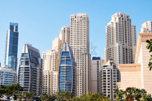Dubai cityscape at daylight. Clear sky. United Arab Emirates - Starpik Stock