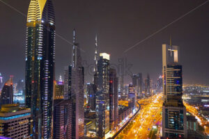 Dubai night cityscape with highway and ligths. United Arab Emirates - Starpik Stock