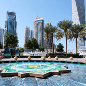 Marina pond in Dubai. Tower and cityscape on background, United Arab Emirates - Starpik Stock