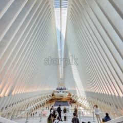 NEW YORK, USA, SEPTEMBER 19: Vertical shot of incredible World Trade Center Station's interior space with lots of busy and relaxing people - Starpik Stock