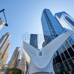 NEW YORK, USA, SEPTEMBER 19: Wide shot of the World Trade Center Station with lots of high modern buildings in the background - Starpik Stock