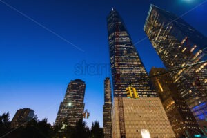 New York City at night, tall buildings with lights, Manhattan, USA - Starpik Stock
