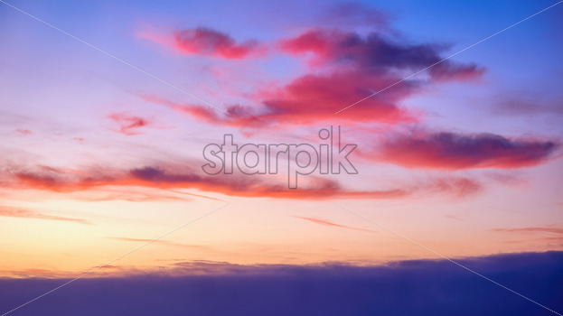 Pacific ocean and sky with blue – orange clouds at sunset in Los Angeles, USA - Starpik Stock