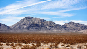 Plain with bushes, hills on the background in Nevada, USA - Starpik Stock