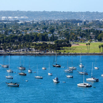 Sailing boats in waterfront area. Cityscape on background. San Diego, California - Starpik Stock