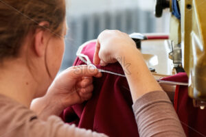 Seamstress at the work with fabric - Starpik Stock