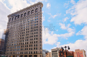 a horizontal shot of the The Flatiron Building in New York City, USA - Starpik Stock
