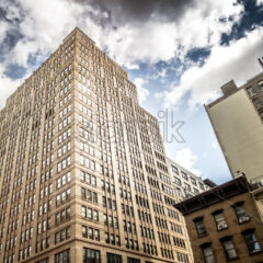 High and modern building in New York, USA. Vibrant colors - Starpik Stock