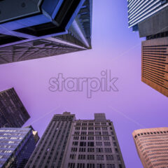 High and modern buildings in New York, view from below, USA. Vibrant colors - Starpik Stock