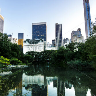 Lake in Central Park with skyscrapers on the background in New York, USA. Vibrant colors - Starpik Stock