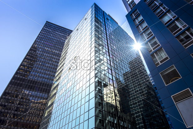 Modern building with glass facade in New York, USA. Vibrant colors - Starpik Stock