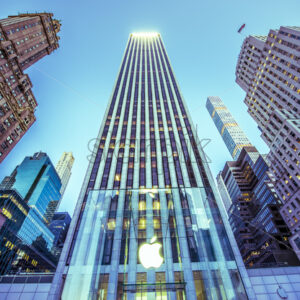 NEW YORK, USA – SEPTEMBER 19, 2019: Apple Store located in a skyscraper with high buildings around. Vibrant colors - Starpik Stock