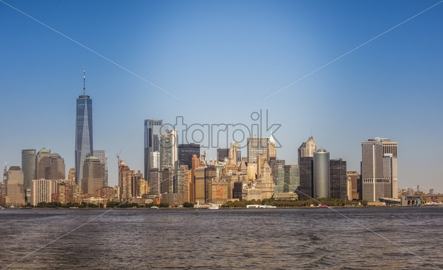 View of Manhattan from the water, multiple high buildings in New York, USA. Vibrant colors - Starpik Stock
