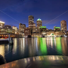 City of Boston with buildings and port at night, water reflections and blue sky with stars - Starpik Stock