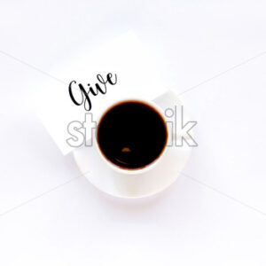 A cup of coffee on a white dish with a note with message. White background - Starpik Stock
