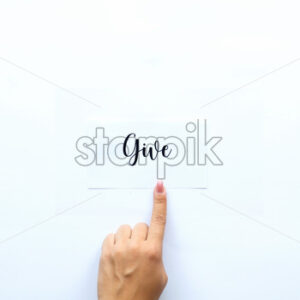 Female finger showing on a note with a word Give on it. White background - Starpik Stock