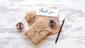 Gift boxes, fir cones, note with a message and a pencil. White background. Holiday concept. Top view - Starpik Stock