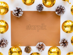 Table with holiday attributes, decorations, and fir cones. White background. Holiday concept. Top view - Starpik Stock
