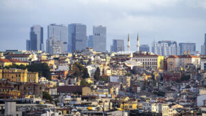 A lot of low residential and high modern buildings in the distance, sunlight and cloudy sky in Istanbul, Turkey - Starpik Stock