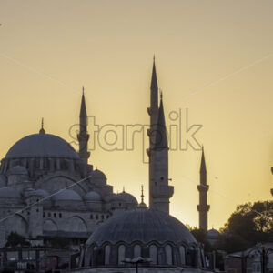 A mosque with towers at sunset in Istanbul, Turkey - Starpik Stock
