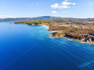 Church and sea with beach and mountains in Nea Roda, Halkidiki, Greece - Starpik Stock