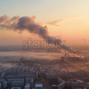 Cityscape of Bucharest from a drone, rows of residential buildings, thermal station with fog getting out and other the ground, ecology idea, Romania - Starpik Stock