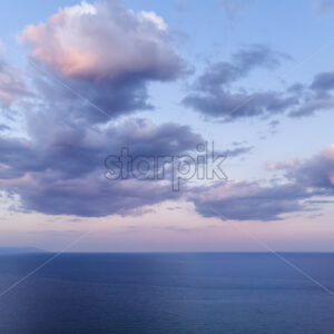 Dark blue and purple sky and sea after storm in Greece - Starpik Stock