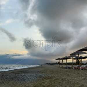 Dark purple sky and clouds after the storm in Asprovalta, Greece - Starpik Stock