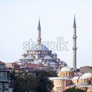 Gazi Atik Ali Pasha Mosque in Istanbul at cloudy weather with residential buildings around, Turkey - Starpik Stock