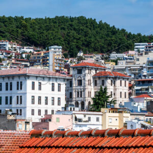 Levels of multiple residential and state buildings located on the hills in Kavala, Greece - Starpik Stock