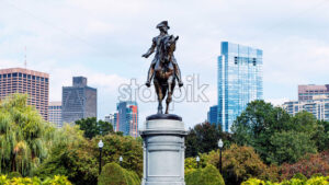 Modern buildings and flowers in park in Boston city, United States of America - Starpik Stock