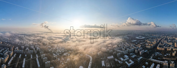 Panorama of Bucharest from a drone, districts of residential buildings, fog other the ground, Romania - Starpik Stock